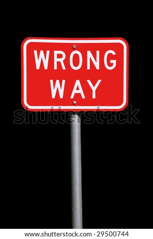 Wrong Way Traffic Sign - Current Australian Road Sign, isolated on black - stock photo