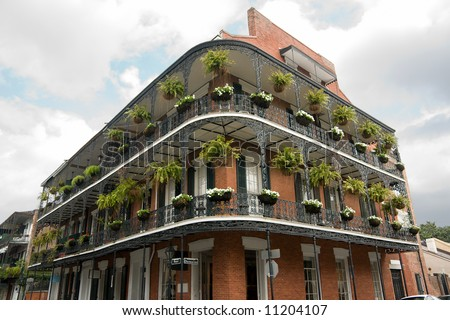 wrought iron balconies on building in New Orleans French Quarter - stock photo