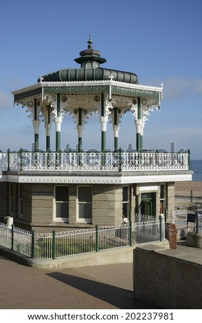 Wrought iron bandstand on the seafront promenade at Brighton. East Sussex. England - stock photo
