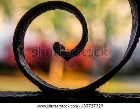 Wrought iron design in Charleston, SC with gardens in background. - stock photo