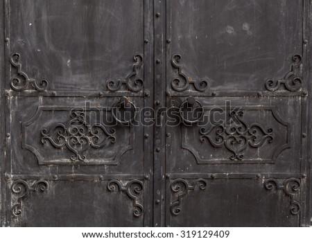 wrought iron doors. with circular handle - stock photo