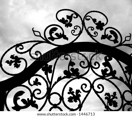 Wrought Iron Gate -- seen against a dramatic sky