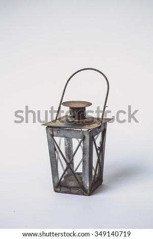 Wrought iron, lantern isolated in white - stock photo