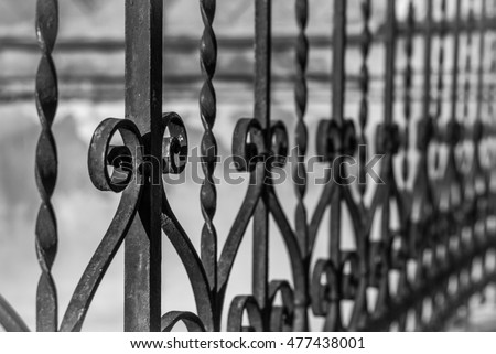 Wrought iron, metal fence, detail, twisted, black and white photo