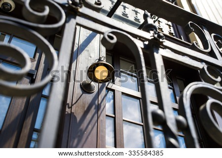 wrought porch on a background of the old house - stock photo