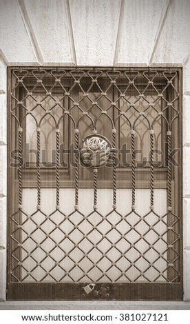 Wrought the lattice on the window. Old style, sepia