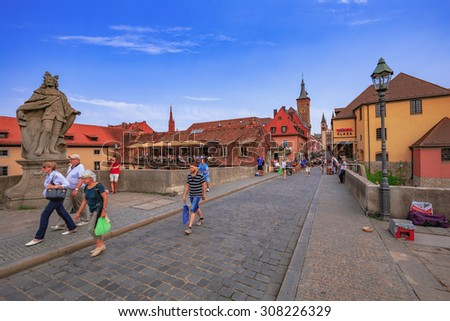 WUERZBURG, GERMANY - AUGUST 14 2015: Wuerzburg Old Town and Inner City in Franconia, Germany in Bavaria on a warm summer august day. Picturesque historical buildings
