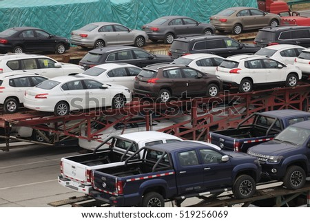 Wuhan China -2016 April 2: the highway service area, dozens of trucks loaded with new car stops, like long pendulum. China's auto production and marketing rapid growth, ranking first in the world.