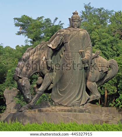 WUHAN, CHINA - JUNE 23, 2015: statue of chinese warrior with horse in park of Wuhan