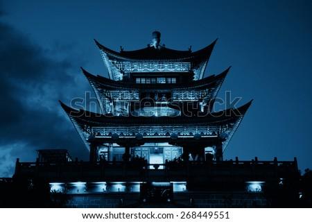Wuhua House at night as the landmark of Dali Town, Yunnan, China. - stock photo