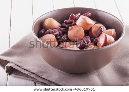Wurstel and beans in a cup, horizontal image