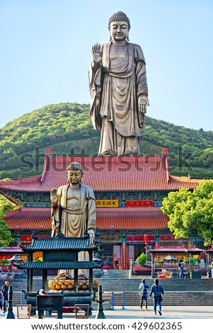 WUXI, CHINA - April 18, 2016: At more than 88 metres high, the Grand Buddha at Ling Shan is a bronze Amitabha standing Buddha outdoor, weighing over 700 tons. It was completed in the end of 1996 - stock photo