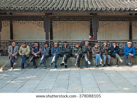 WUZHEN, SHANGHAI-DECEMBER 2, 2008: locals relaxing in the main street. Wuzhen water village is Shanghai tourist attraction with more than 100000 visitors per year. - stock photo