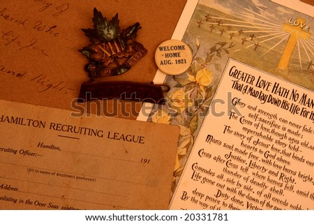 WW1 artifacts - recruitment card, badges, death letter - stock photo