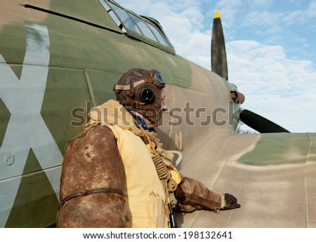 WW2 Fighter Pilot With Hurricane Aircraft - stock photo