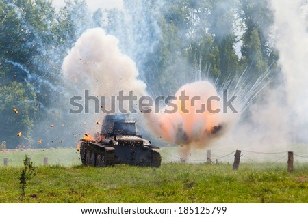 WW2 German light tank Panzer 38 (t), and the explosion of a shell hit - stock photo