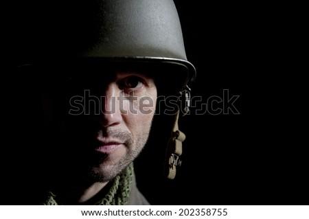WW2 US Soldier Portrait In Shadow - stock photo