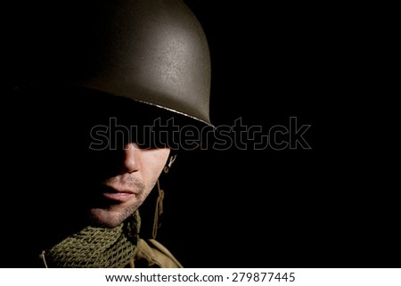 WW2 US Soldier With Face In Shadow - stock photo