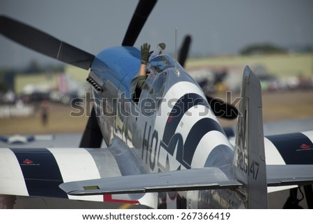 WW2 vintage P51 Mustang fighter aircraft at the Flying Legends Air Display held at Duxford airfield,Cambridgeshire,UK.taken 14/07/2013 - stock photo