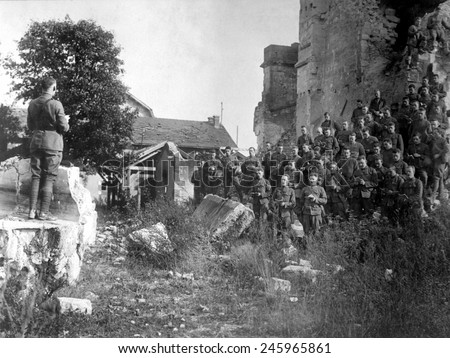 WWI American soldiers of the 101st Field Signal Battalion at services in the ruins of a church destroyed by shell fire. Verdun, France. Oct. 18, 1918.