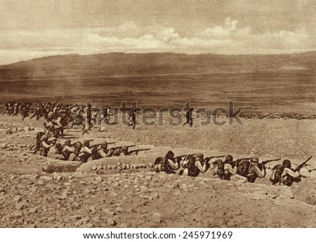 WWI. Turkish troops leaving their trenches for a charge in a battle with French and British Troops in the early stages of the Gallipoli fighting. 1915. - stock photo