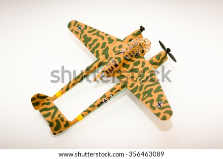 WWII model kit plane on a white background - stock photo