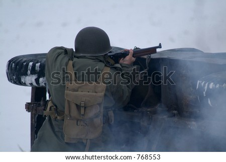 WWII Soldier in a winter setting. (firing a rifle)