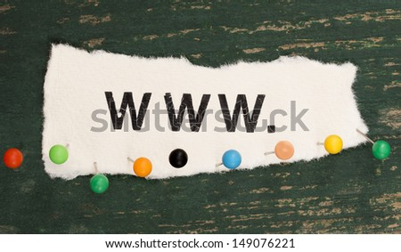 WWW on the wooden background with colorful pins - stock photo