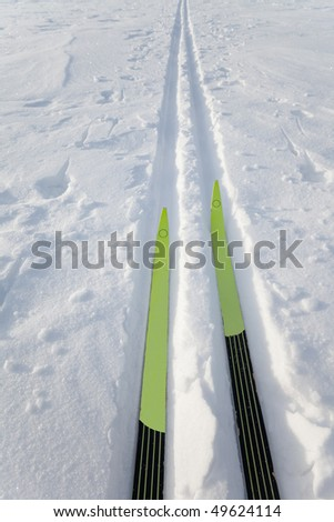 X-country skiing. Cross country skies in tracks. - stock photo