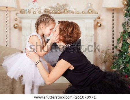 x-mas and happy people concept - hugging mother and daughter - stock photo