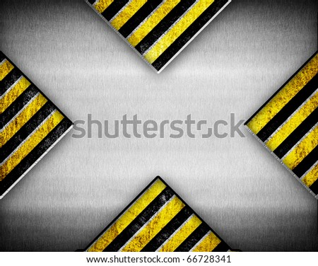 X pattern metal on warning stripe background