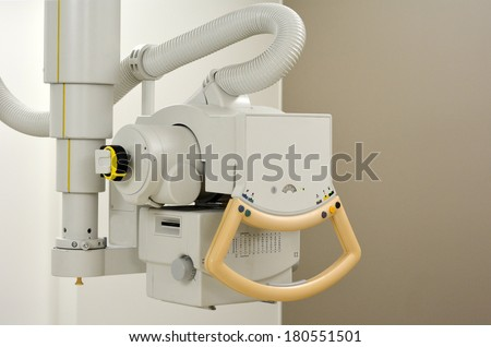 X-ray generator device in radiology room. Concept photo of health and medical care. - stock photo