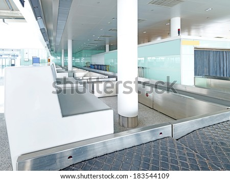 X-ray machine at the airport check-in counter.  - stock photo