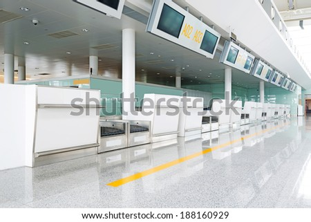X-ray machine at the airport check-in counter  - stock photo