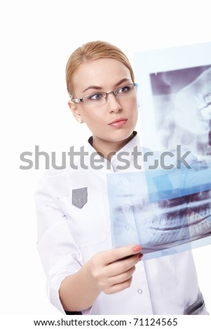 X-ray of a young doctor looks on a white background