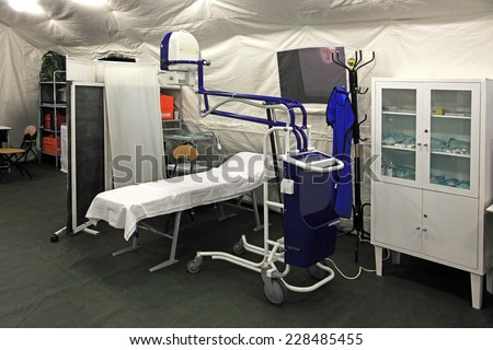x-ray study in a field hospital in a tent - stock photo