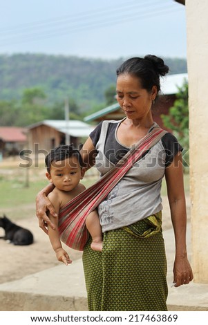 XEKONG, LAOS, APRIL 12 : An unidentified Laos girl with her daughter in the village of Xekong, Laos, on April 12, 2014