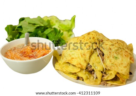 Xeo cake (banh xeo) with vegetables and fish sauce, vietnamese crepe, vietnamese crispy pancake, vietnamese cuisine in white background.