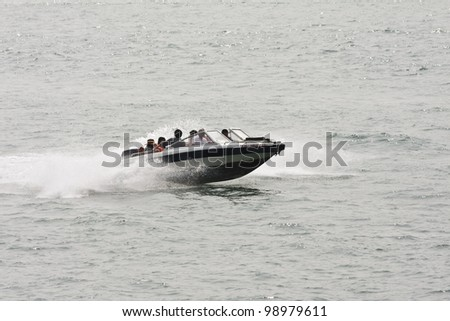 XIAMEN-CHINA-MARCH 22, 2009. Speed boat on March 22, 2009 in Xiamen. The fastest crossing from Xiamen to its famous Gulangyu (Piano Island) is by speed boat. I take 3 minutes and costs 50 Yuan. - stock photo