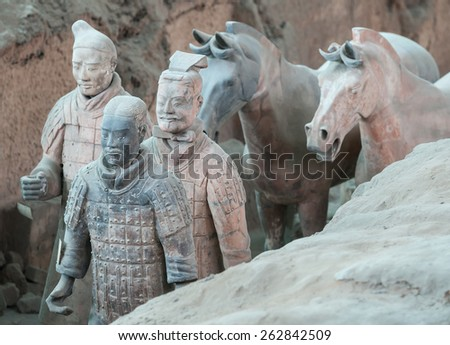 XIAN - APRIL 9: exhibition of the famous Chinese Terracotta Warriors and Horses on April 9, 2014 in Xian, China.The terracotta warriors are made in 210-209 BCE to protect the emperor in his afterlife. - stock photo