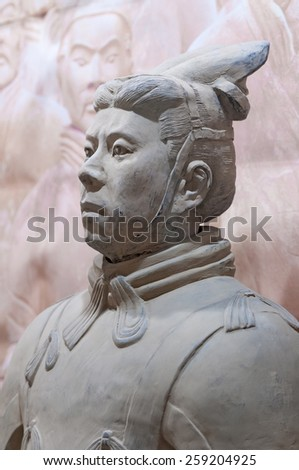 XIAN - APRIL 9: exhibition of the famous Chinese Terracotta Warriors on April 9, 2014 in Xian, China. The terracotta warriors are made in 210 - 209 BCE to protect the emperor in his afterlife. - stock photo