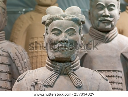 XIAN - APRIL 9: exhibition of the famous Chinese Terracotta Warriors on April 9, 2014 in Xian, China. The terracotta warriors are made in 210-209 BCE to protect the emperor in his afterlife. - stock photo