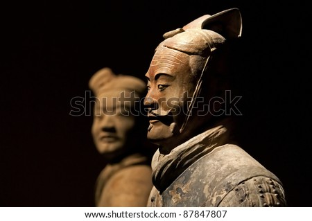 XIAN - APRIL 6: famous Chinese terracotta army figures are exhibited on April 6, 2011 in Xian, China. The figures date back to 210 BC and belong to China's most important discoveries. - stock photo