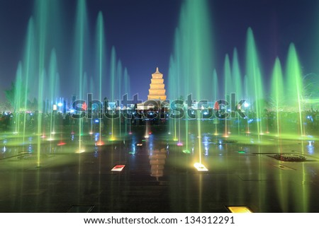 xian at night,giant wild goose pagoda with colorful fountains, China. - stock photo