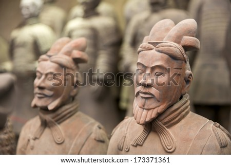 "Xian, China. June 28: The Terracotta Army or the ""Terra Cotta Warriors and Horses"" buried in the pits next to the Qin Shi Huang's tomb in 210-209 BC. June 28, 2013 in Xian of Shaanxi Province, China - stock photo"