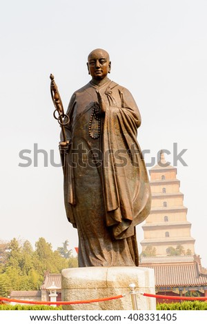 XIAN, CHINA - MAR 30, 2016: Monk statue at the Giant Wild Goose Pagoda complex, a Buddhist pagoda Xi'an, Shaanxi province, China. It was built in 652 during the Tang dynasty. UNESCO world heritage - stock photo