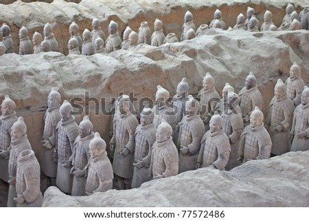 XIAN, CHINA - MAY 30: Terracotta warriors excavation are displayed, 2011 in Xian, China. The figures, discovered in 1974, include warriors, chariots, horses, officials, acrobats, strongmen and musicians. - stock photo