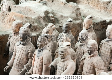 XIAN,CHINA - NOVEMBER 11 :The Terracotta Army or the Terra Cotta Warriors buried in Qin Shi Huang Emperor's tomb in 210-209 BC. November 11, 2011 Xian, China.  - stock photo