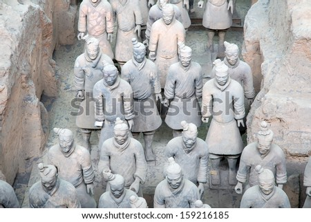 XIAN, CHINA OCTOBER 14: Terracotta Army on October 14, 2013 in Xian, China. Terracotta Army is a collection of terracotta sculptures depicting the armies of Qin Shi Huang, the first Emperor of China.  - stock photo