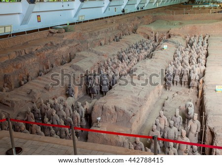 XIAN, SHANXI/CHINA-MAY 16: Emper Qin's Terra-cotta warriors and horses Museum on May 16, 2016 in Xian, Shanxi, China. The picture shows  Terra-cotta warriors in Pit 1.  - stock photo